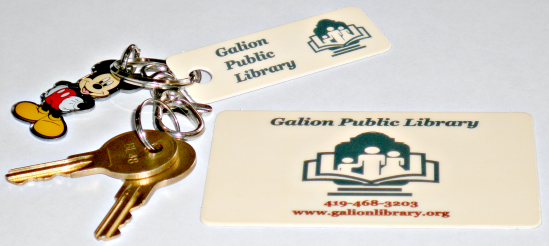 [Photo of library card and keychain]