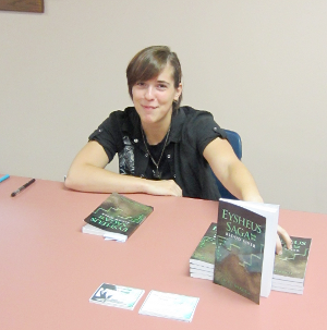 [photo of Esther Mendell with several copies of her book]